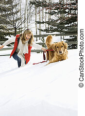 Woman playing with dog - Attractive smiling mid adult...