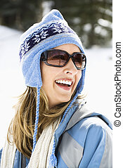 Woman in ski cap. - Attractive laughing mid adult Caucasian...