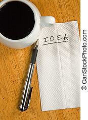 Idea on a Napkin - A napkin idea with coffee cup and a pen