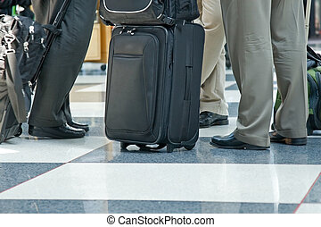Airport Terminal and Travellers - Airline travellers and...
