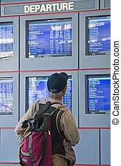 Airport Information Boards - Travellers and businesspeople...