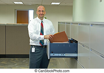 Corporate Office Employee - A man in his corporate office...