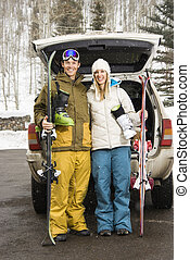 Couple going skiing - Young couple wearing winter clothes...