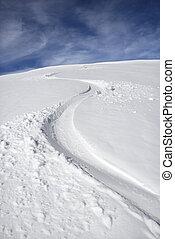 Snowmobile trail. - Snowmobile trail in snow.