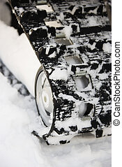 Snowmobile track. - Snowmobile rubber track in snow.