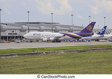 Bangkok-JULY25:thaiairway cargo plane parking at...