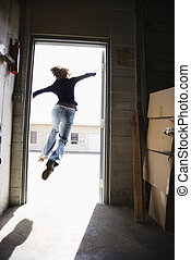 Woman leaping - Woman running and jumping through open door...