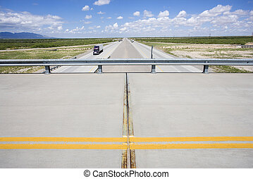 Overpass with highway - Overpass with highway below with...