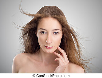 Young beautyfull woman touching her face - Portrait of young...