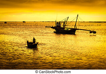 Fishery boat in sunset - Siluated of traditional fishery...