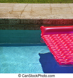 Pink float in  pool. - Pink float in empty swimming pool.