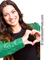 Heart form - Beautiful woman making a heart shape with her...
