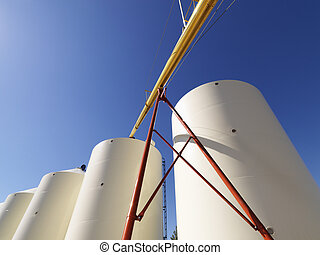 Grain silo storage - Low angle view of metal grain storage...