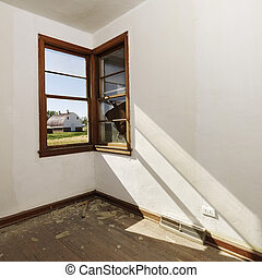Window in empty room. - Empty abandoned room with sunrays...