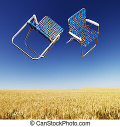 Lawn chairs over wheat field. - Two lawn chairs in mid-air...