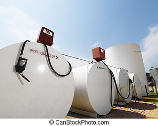 Fuel tanks and pumps. - Fuel tanks labeled unleaded and...