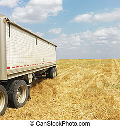Tractor trailer truck in field. - Tractor trailer truck in...