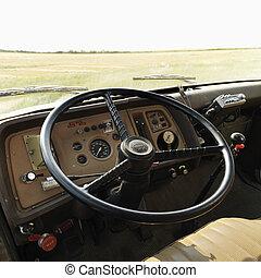 Interior of farm truck. - Interior of farm truck in field.
