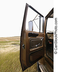 Farm truck with door open. - Farm truck with driver side...