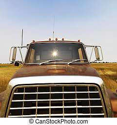 Front view of farm truck - Front view of farm truck in field...
