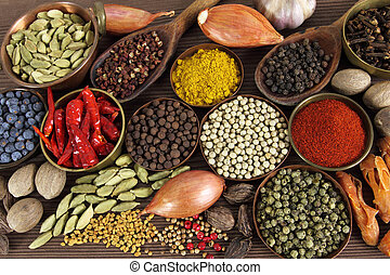 Indian spices - Spices and herbs in metal bowls and wooden...