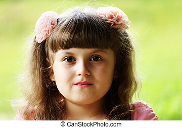 A portrait of a child girl