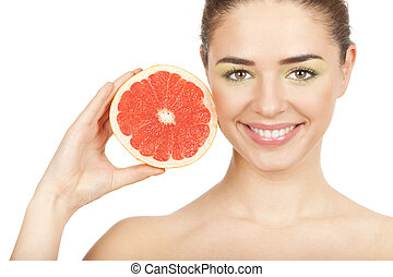 beauty Young beautiful woman holding grapefruit
