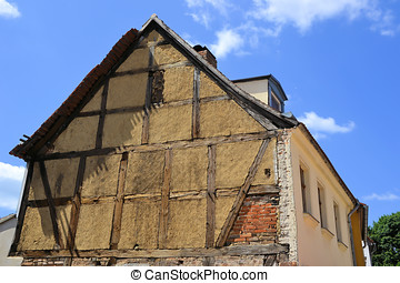 requiring rehabilitation, a half-timbered house