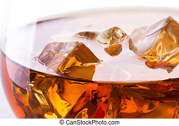 Cognac or brandy macro on white background