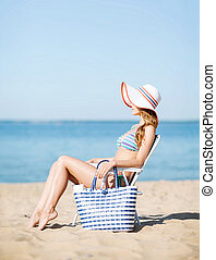 girl sunbathing on the beach chair - summer holidays and...