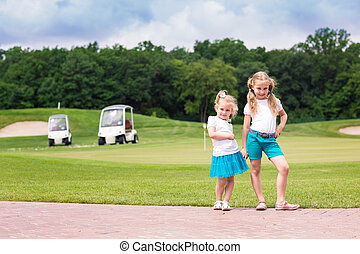 Cute little gilrs on the golf course - Cute little sportive...