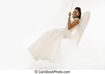 Angelic bride on swing. - Angelic Mid-adult African-American...