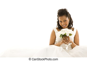 Bridal portrait - Mid-adult African-American bride on white...
