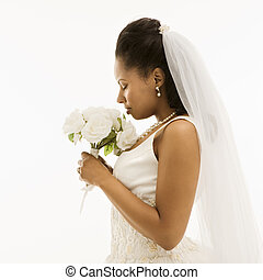 Bridal portrait. - Mid-adult African-American bride on white...