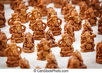 Souvenir figures of gods in the Indian market close up