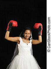 Bride with boxing gloves. - Mid-adult African-American bride...