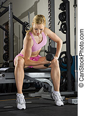 Woman lifting weights. - Caucasian mid-adult woman lifting...