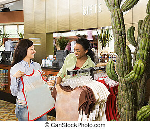 Friends shopping. - Two female friends shopping at a gift...