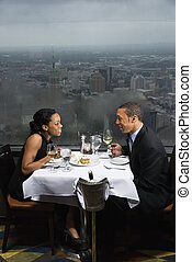 Couple having dinner. - African-American couple having...
