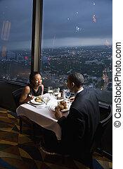 Couple having dinner. - African-American couple having...