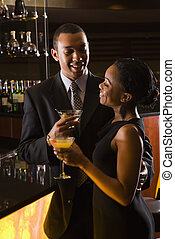 Couple at bar. - African-American couple having drinks at...