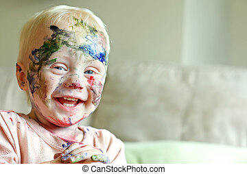 Painted Baby Laughing - A cute baby boy is laughing after he...