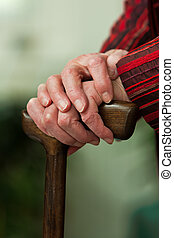 Disabled senior walking stick with a smile - Old woman with...