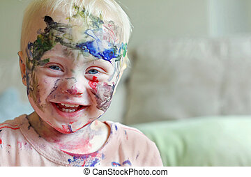 Laughing Baby Covered in Paint - a cute baby boy is laughing...