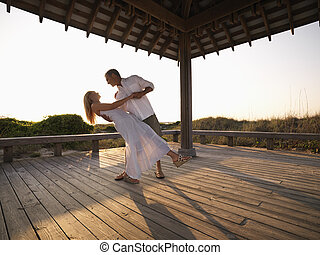 Couple dancing - Caucasian couple dancing under gazebo at...