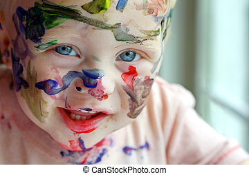 Painted Baby - a close up photo of a baby boy who has...