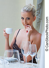 Playful sexy blonde drinking coffee, close-up - Image of...