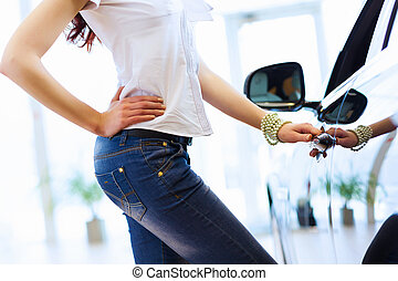 Young lady at car salon - Pretty woman standing near car at...