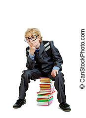 thinker - Cute schoolboy in big round glasses sitting on a...