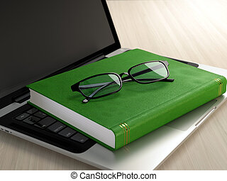 Electronic eduction - Laptop, green book and glasses on...